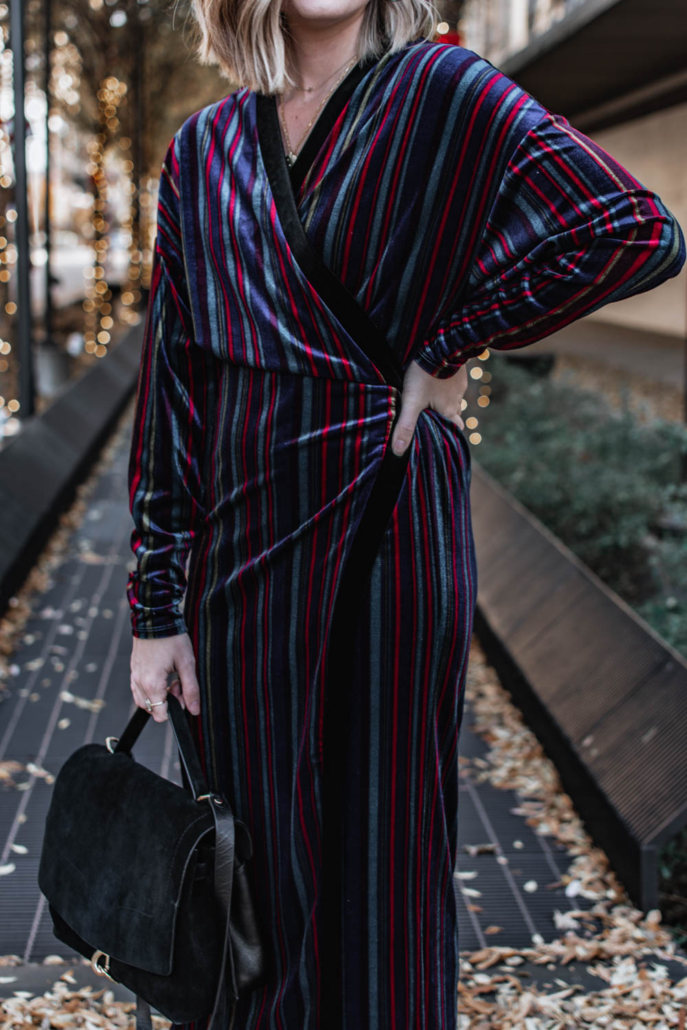 Work appropriate holiday party outfits. Striped velvet wrap dress