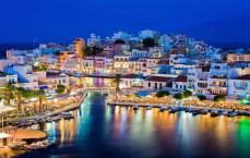 Agios Nikolaos. Agios Nikolaos is a picturesque town in the eastern part of the island Crete built on northwest side of the peaceful bay of Mirabello. Lake Vouliagmeni, Agios Nikolaos, Crete, Greece