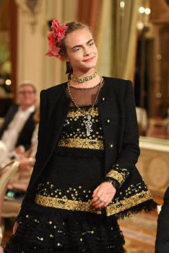 """PARIS, FRANCE - DECEMBER 06: Cara Delevingne walks the runway during """"Chanel Collection des Metiers d'Art 2016/17 : Paris Cosmopolite"""" show on December 6, 2016 in Paris, France. (Photo by Pascal Le Segretain/Getty Images)"""