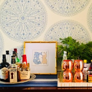Styling Gypsy Interior Design | your guide to simple, stress-free holiday decorating | home bar decor with blue and white wallpaper, original art and fresh evergreens #holidaydecor #christmasdecorations #holidaydecorating #holidaydecorideas #christmasdecorideas #holidaystyle