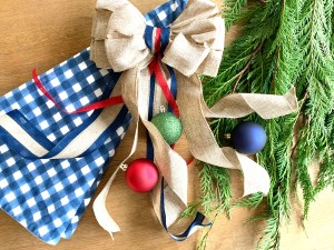 Styling Gypsy Interior Design | your guide to simple, stress-free holiday decorating | christmas decor flat lay with fresh cedar, classic ball ornaments, gingham tree skirt #holidaydecor #christmasdecorations #holidaydecorating #holidaydecorideas #christmasdecorideas #holidaystyle