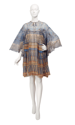 Silk chiffon kaftan, above knee length; the large circular yoke, with keyhole fastening at the neckline, and circular sleeves are in the Knitted Circle print; the main body of the kaftan is in the Feather Sunspray print.