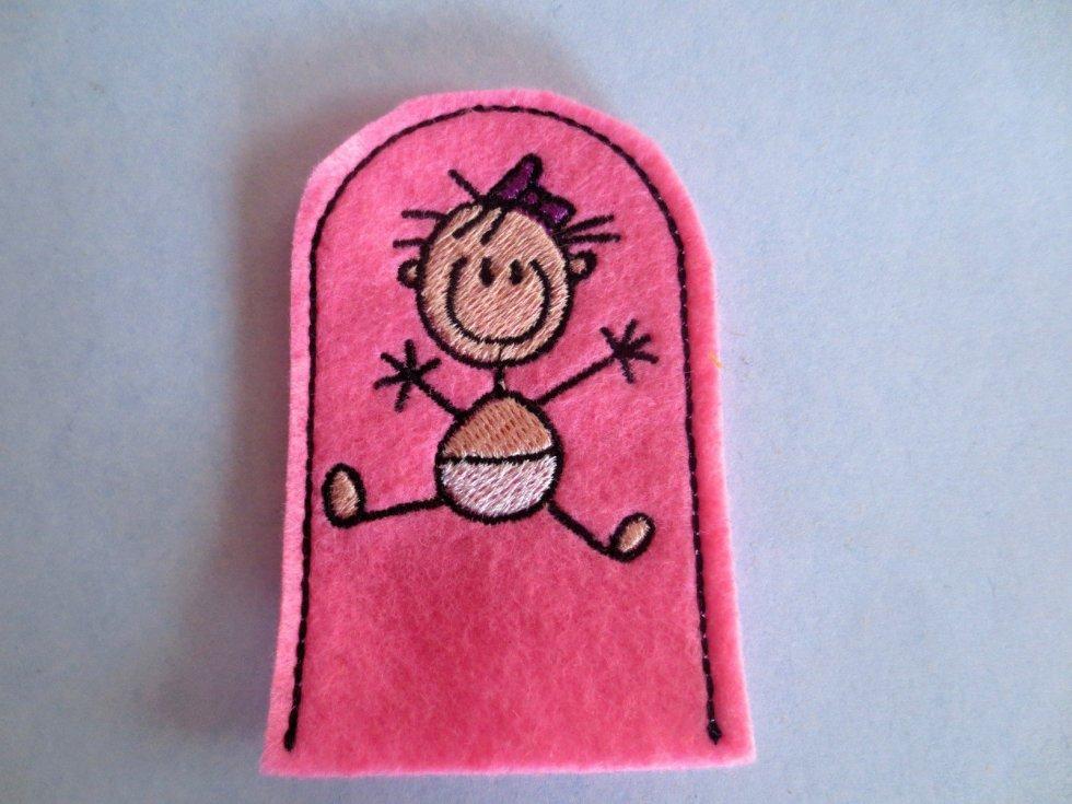 sitting baby girl finger puppet