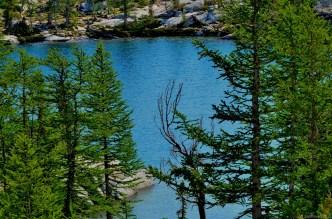Laprechaun Lake between larches