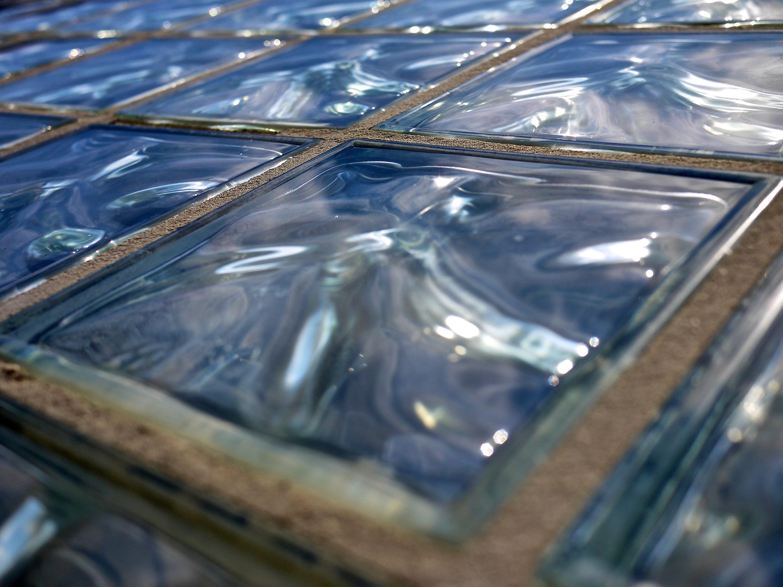 Close up angle on a glass brick wall.