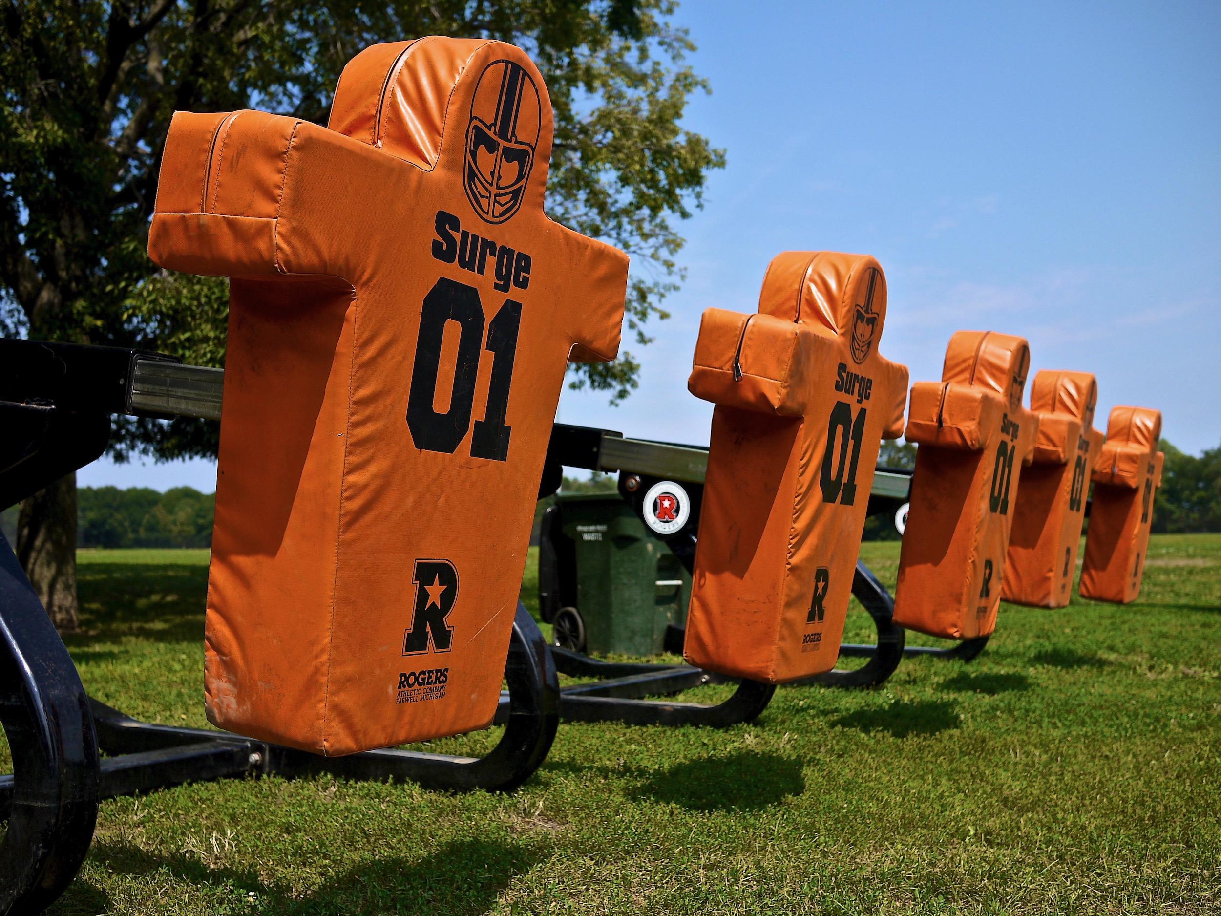 A row of football training dummies.
