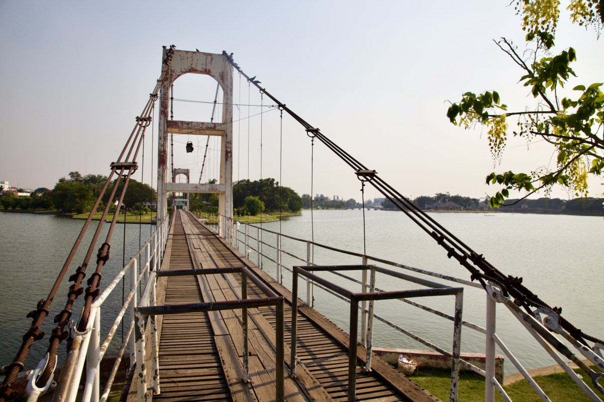 An old bridge that crosses over the Chao Phraya River in Pak Nam Pho, Nakhon Sawan, Thailand.