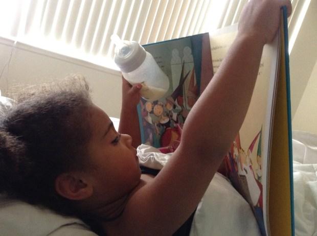 Jasmine reading a book