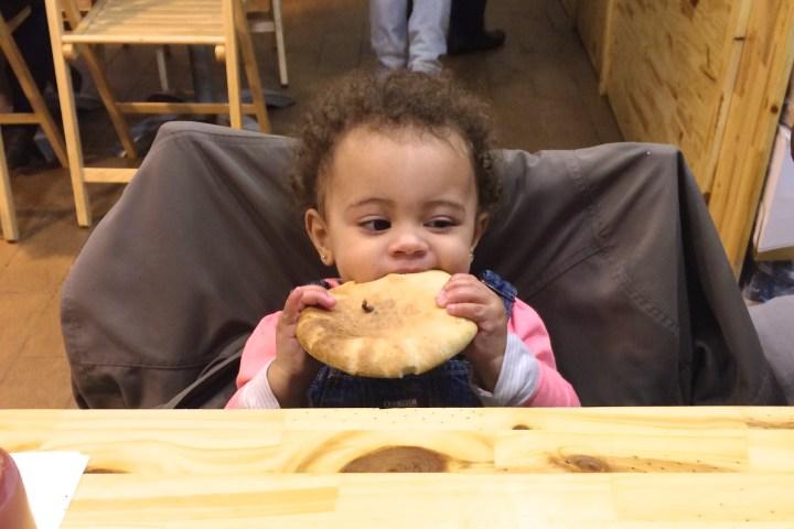 Grace digging into some fresh pita