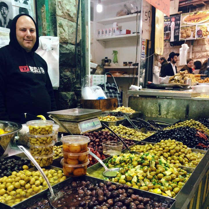 Olive vendor in Shouk Mehane Yehuda (market) Jerusalem