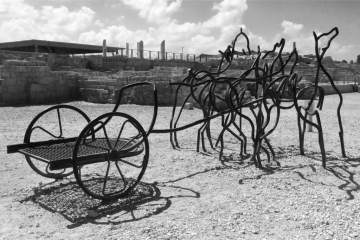 Whimsical sculpture of horses and a chariot at the entrance to Caesarea National Park in Israel