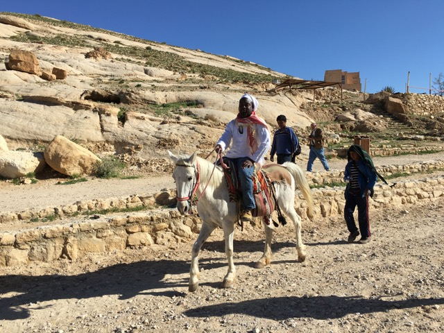 Travel with Kids - Bertrand looking like royalty in Petra