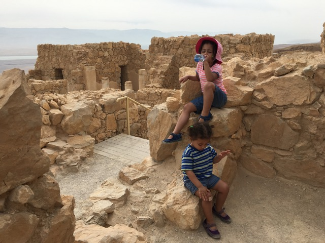 Travel with Kids - Taking a much need water break in Masada