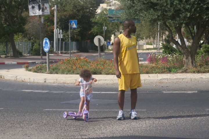 Bertrand and Grace in an intersection on Yom Kippur in Jerusalem