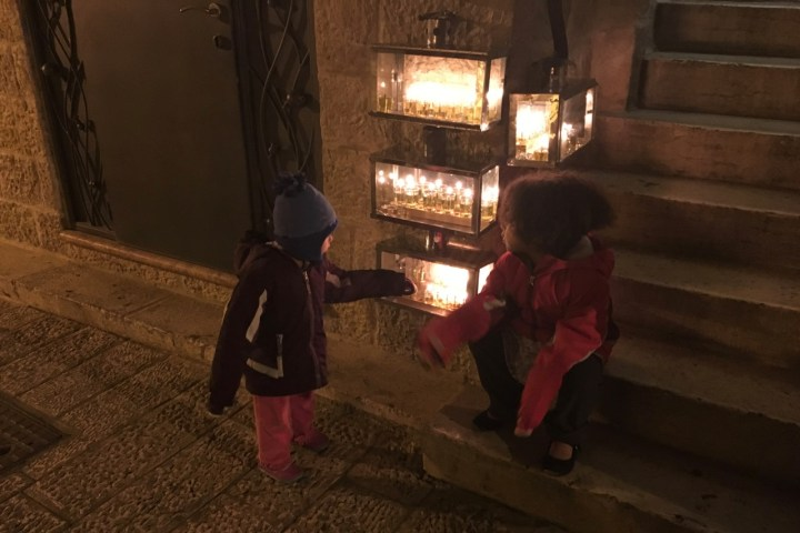 Jasmine and Grace admiring the Chanukiot in the Old City, Jerusalem