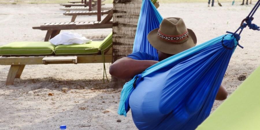 Bertrand relaxing in his hammock at Sipopo Beach, Bioko Island, Equatorial Guinea