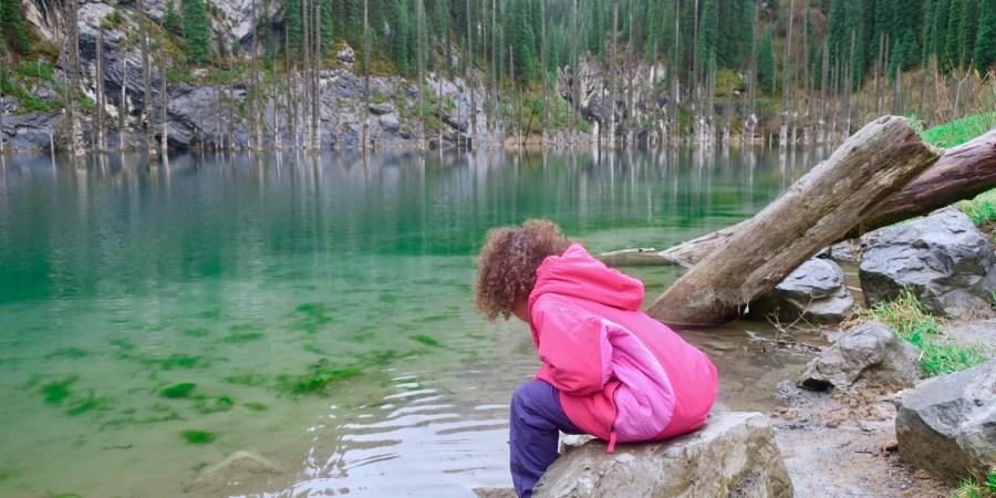 Grace, playing in the mud, at Kolsai Lake, Kazalkstan