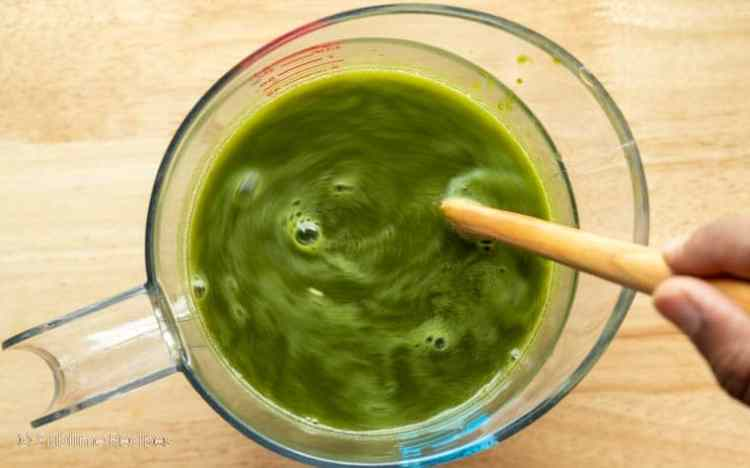 Grinding spicy green water for pani puri
