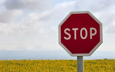 Setting limits - stop sign on road