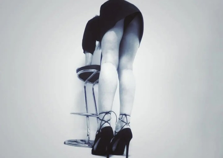 never too old to be naughty - bending over a stool to flash knickers