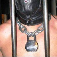 slave locked in cage