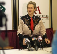 Temple Grandin visits with the media before addressing a packed house at the Arkansas 4-H Center in August 2012.