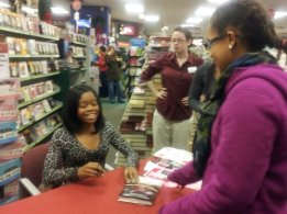 The Signing! Oops she blinked.