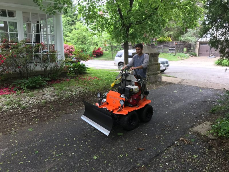 Sidewalk operations -- an equipment operator takes the Snowrator ZX4 for a spin.