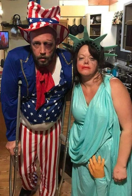"""two costumes of """"currently abused government"""": uncle sam all beat up, and a groped statue of liberty"""