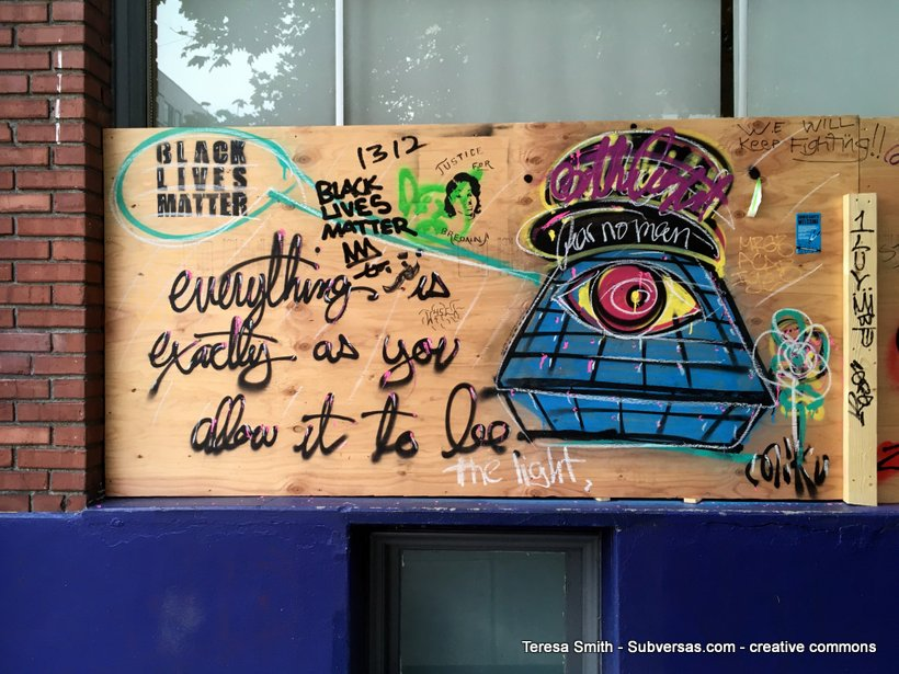 "Hand-painted sign: ""Everything's as you allow it to be."""
