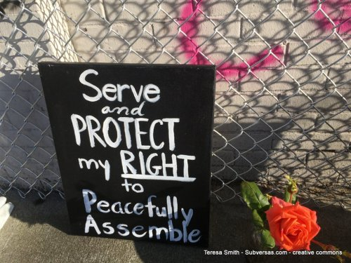 sign at CHAZ: Serve and protect my right to peacefully assemble