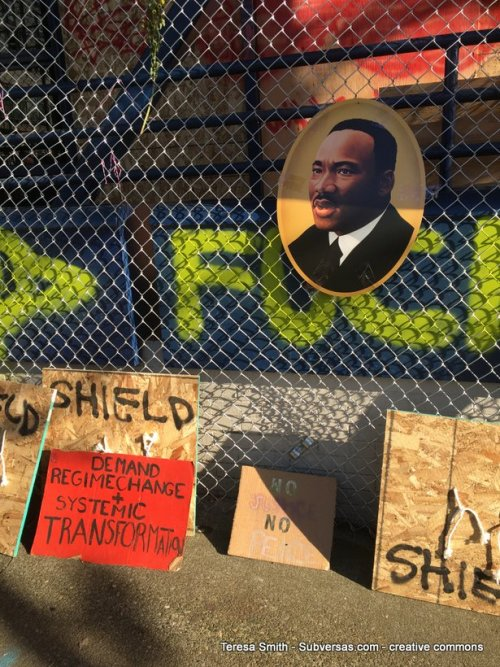 various signs and MLK art at capital hill autonomous zone