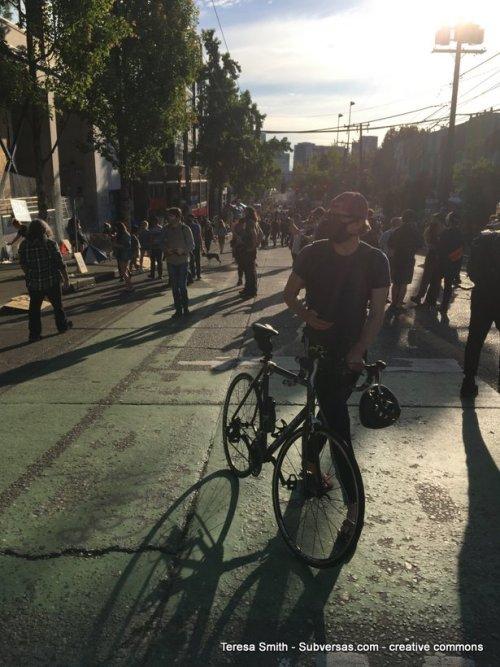 bicyclist at capital hill autonomous zone