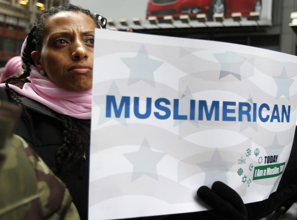 """A woman holds a sign at the """"Today, I Am A Muslim, Too"""" rally in New York City March 6, 2011. The rally was held in response to the upcoming Congressional hearings led by Peter King (R-LI) to protest the targeting of American Muslims and Arabs. REUTERS/Jessica Rinaldi (UNITED STATES - Tags: SOCIETY POLITICS)"""