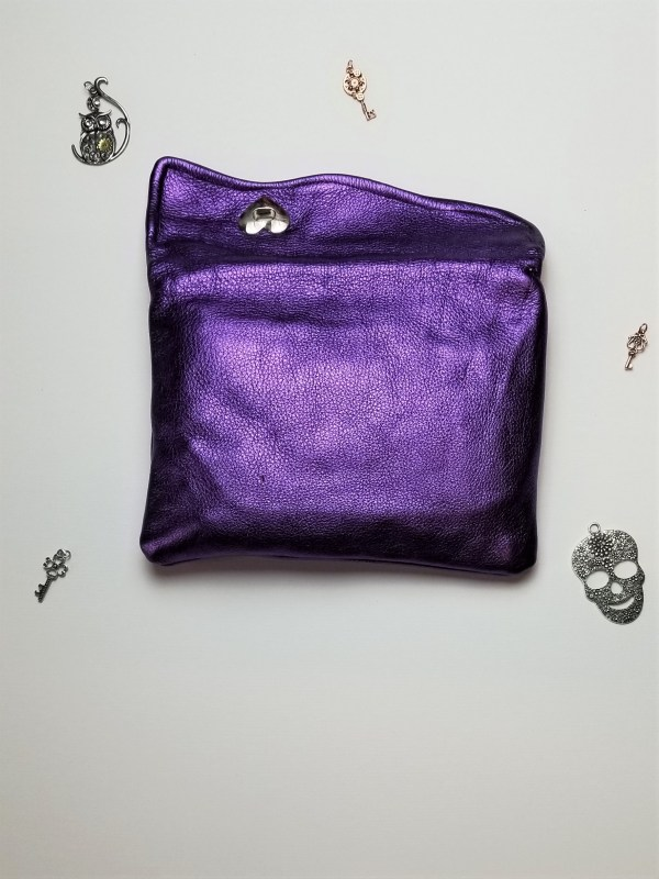 Back view of purple metallic clutch in the open position