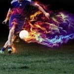 シュートをするサッカー選手画像