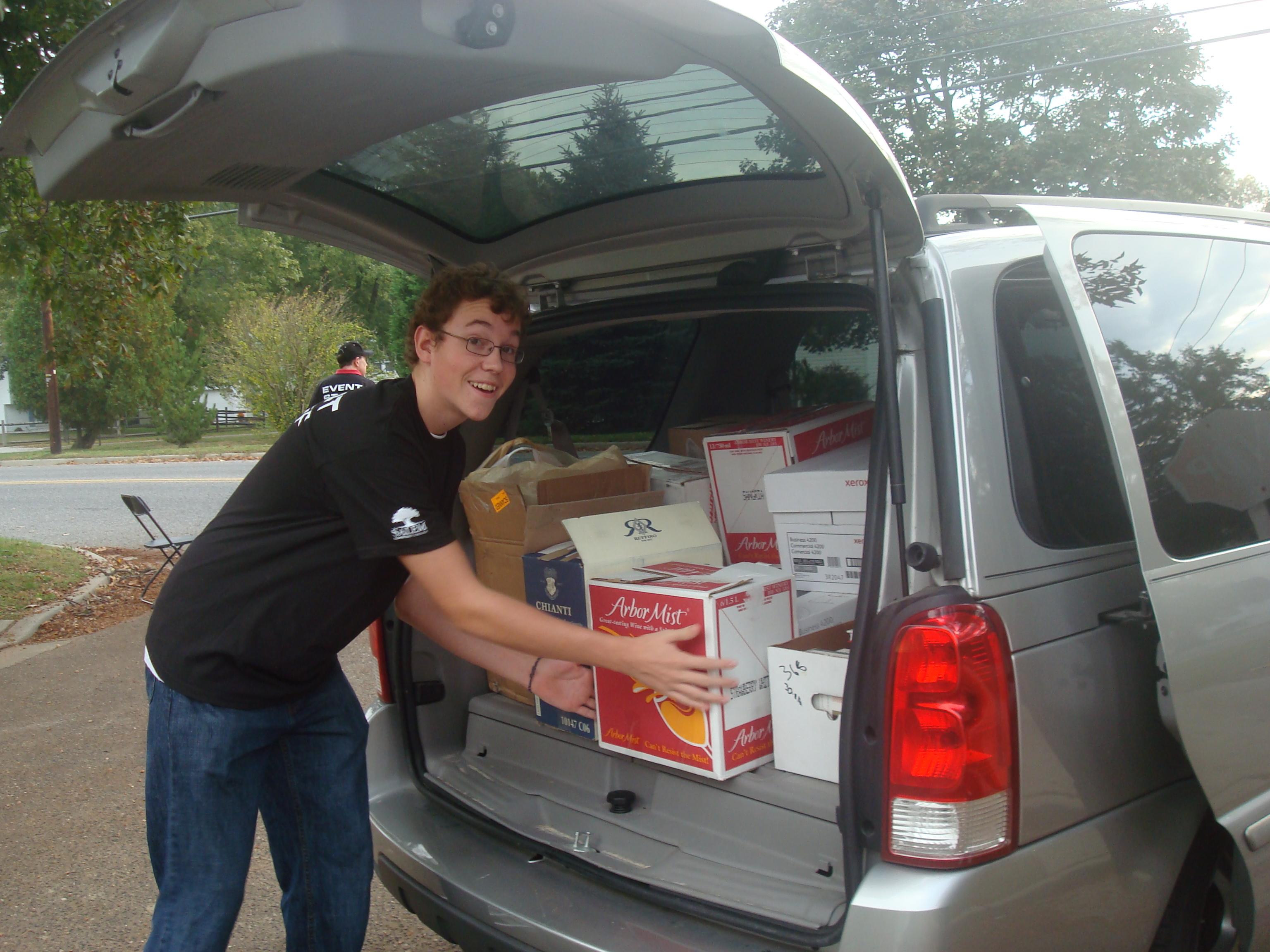 Oliver Hames of Team 365 loads up the first van.