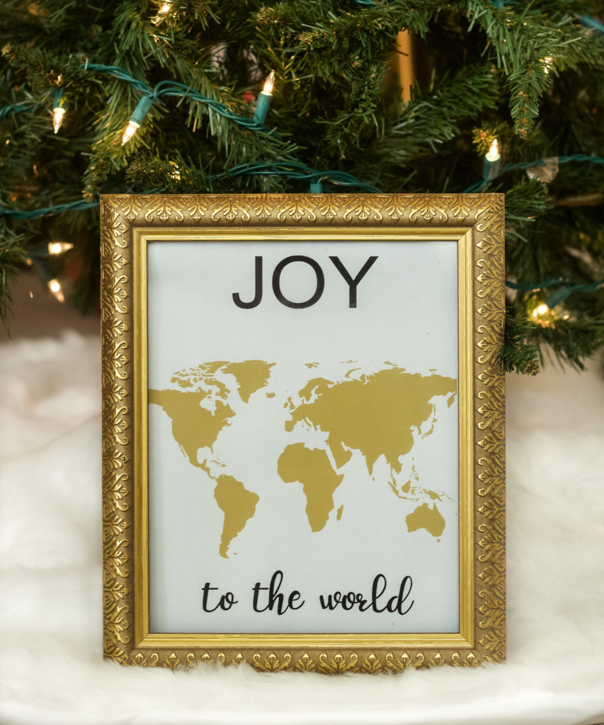 Joy to the World Print in a gold frame.