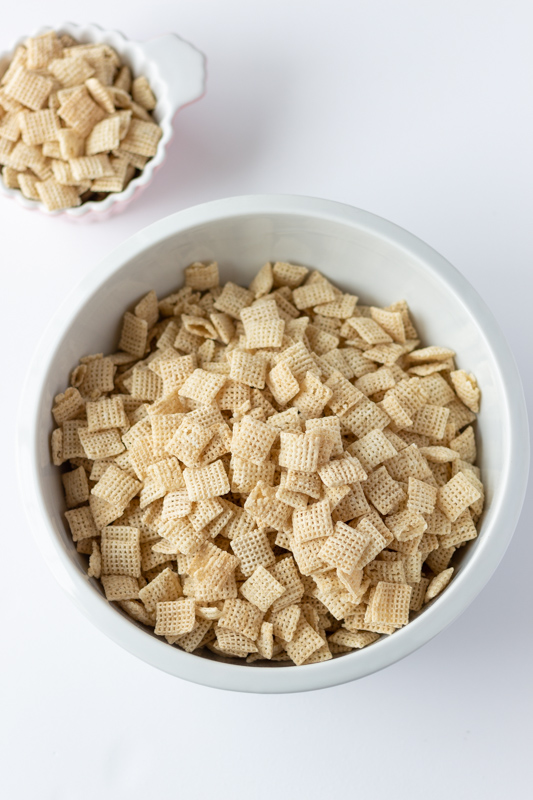 Plain Rice Chex in a large white bowl.