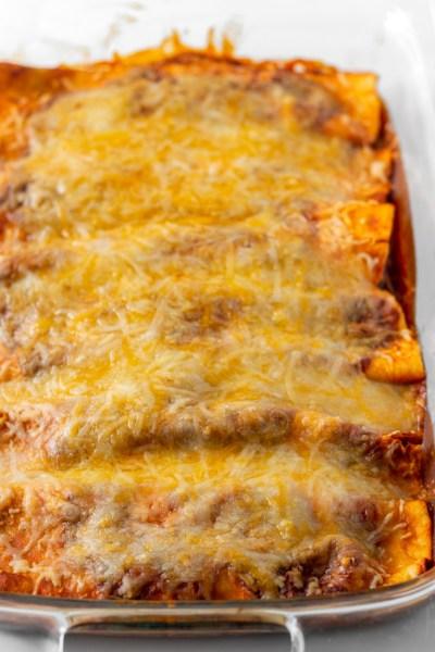 Cheese Enchiladas in casserole dish.