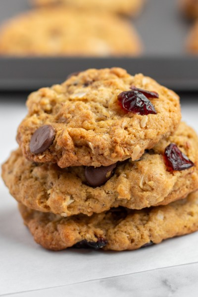 Stacked coconut chocolate chip oat cookies.