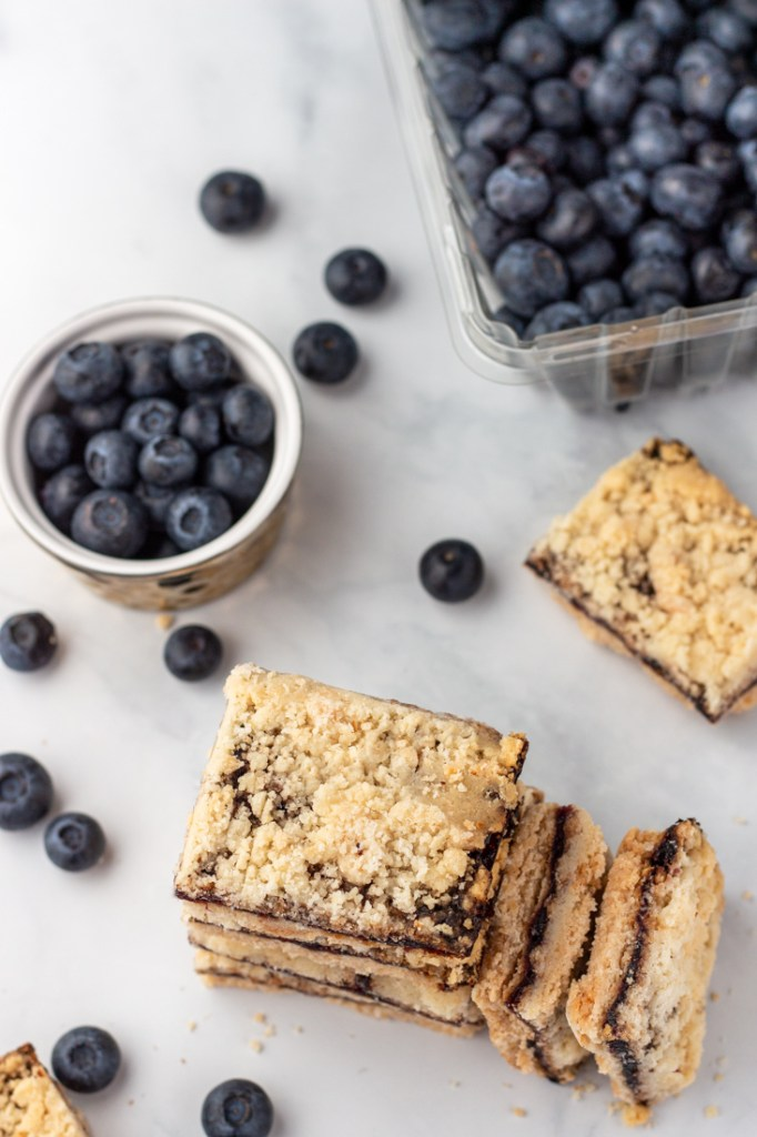 Blueberry bars on a marble surface.