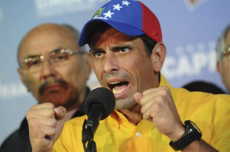 Capriles derrota efe