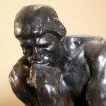 Sculpture of a person deep in thought.