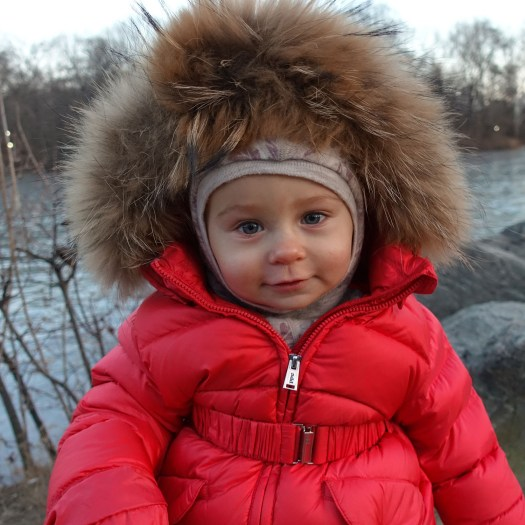 Anastasia in red coat, at twilight in Central Park