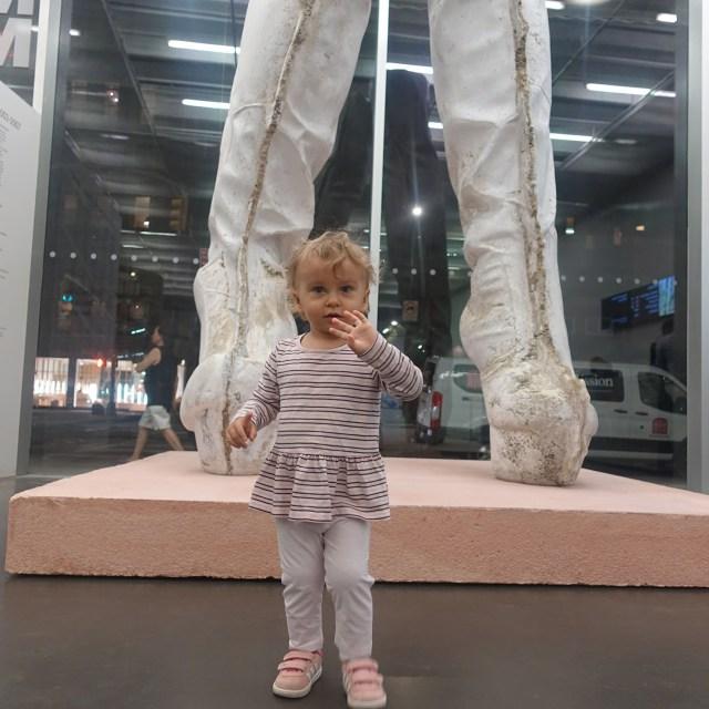 Anastasia Sudentas in New Museum, with Sarah Lucas's sculpture