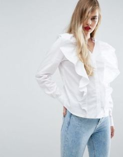 ASOS - http://www.asos.com/asos/asos-shirt-with-v-neck-and-exagerated-ruffle-front/prd/7786952?CTARef=Saved%20Items%20Image