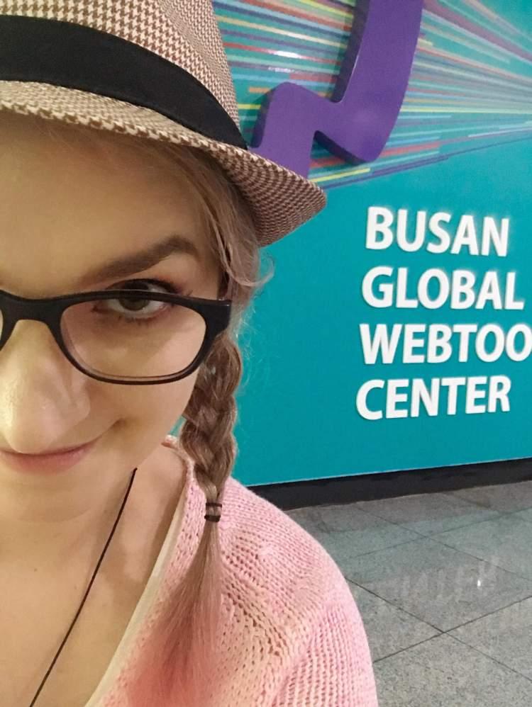 girl with glasses looking at the camera , Busan global weebtoon center. Busan South korea