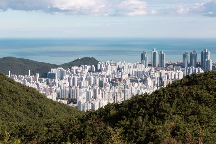 Busan South Korea, green mountains, white building , blue sea