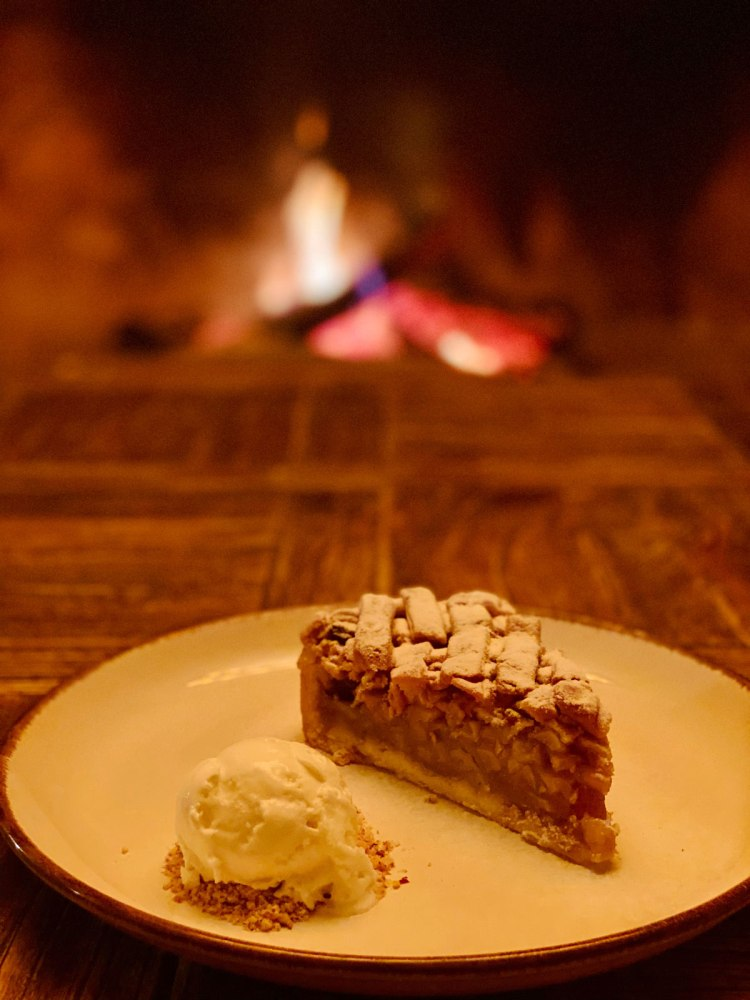 apple pie with a dash of ice cream , by the fireplace